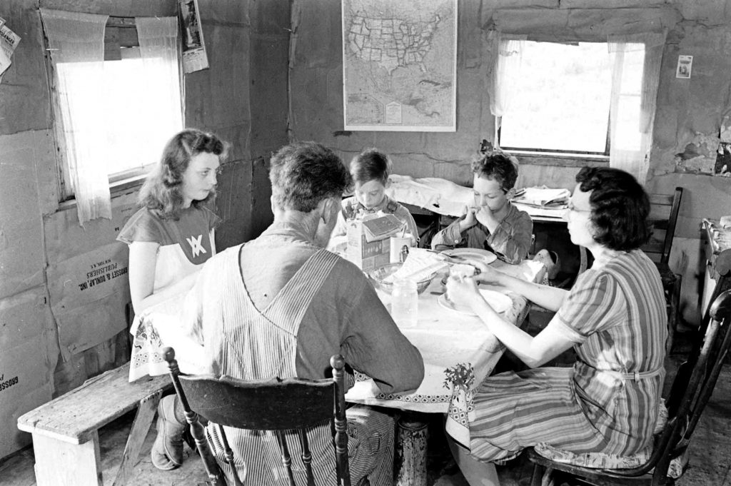 Oklahoma farming family at meal, 1942.