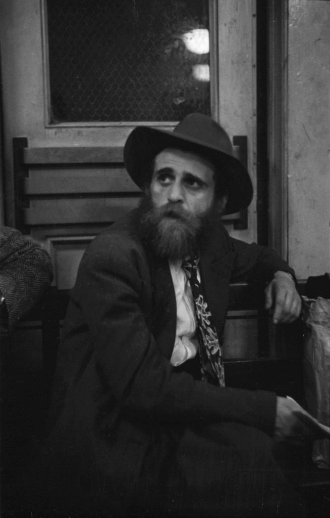 Twenty-four-year-old Schulim Pewzner, a rabbinical student from Warsaw, Poland, at Ellis Island, 1950.