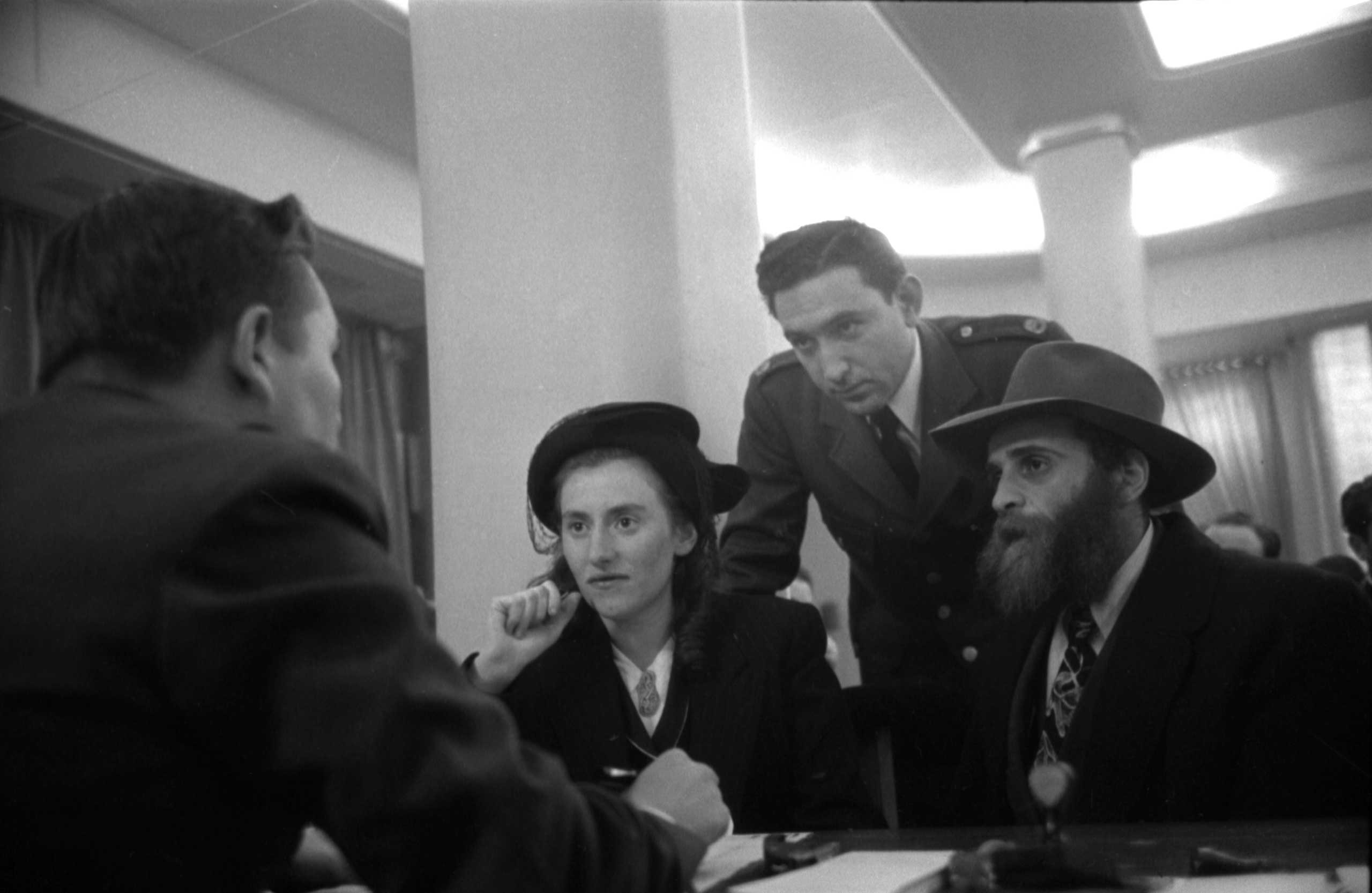 Rachel and Schulim Pewzner, from Warsaw, Poland, interviewed at Ellis Island, 1950.