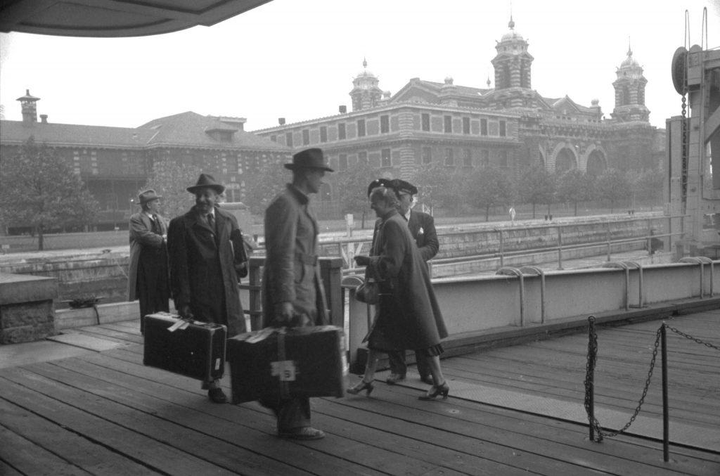 Boarding a ferry at Ellis Island, 1950.