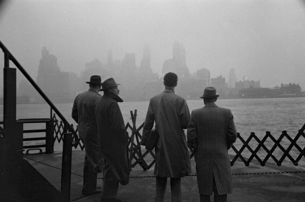 On a ferry in New York Harbor, looking at lower Manhattan, 1950.