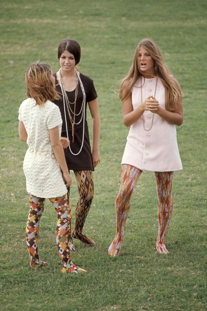 "Corona del Mar High School students Kim Robertson, Pat Auvenshine and Pam Pepin wear ""hippie"" fashions, 1969."