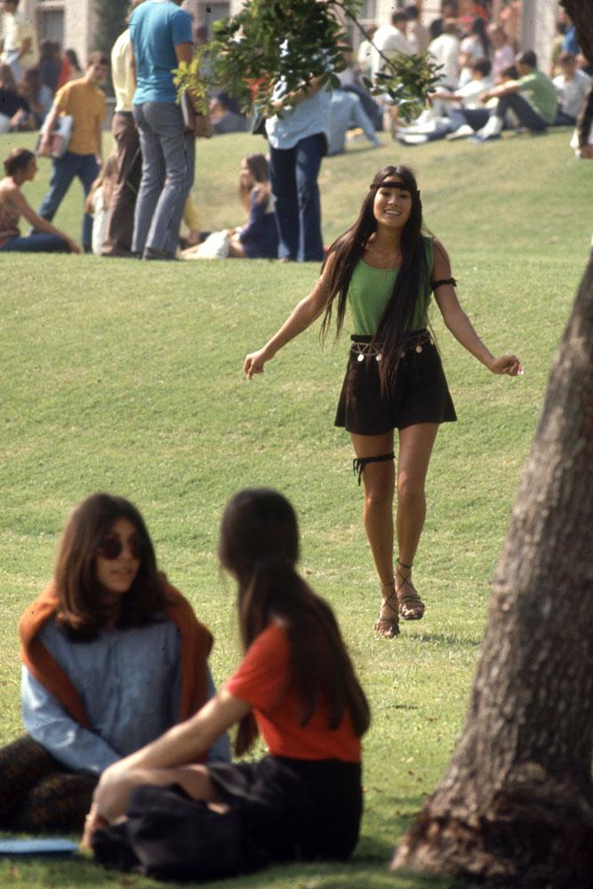 "A Southern California high school student walks toward classmates while wearing the ""Mini Jupe"" skirt, 1969."