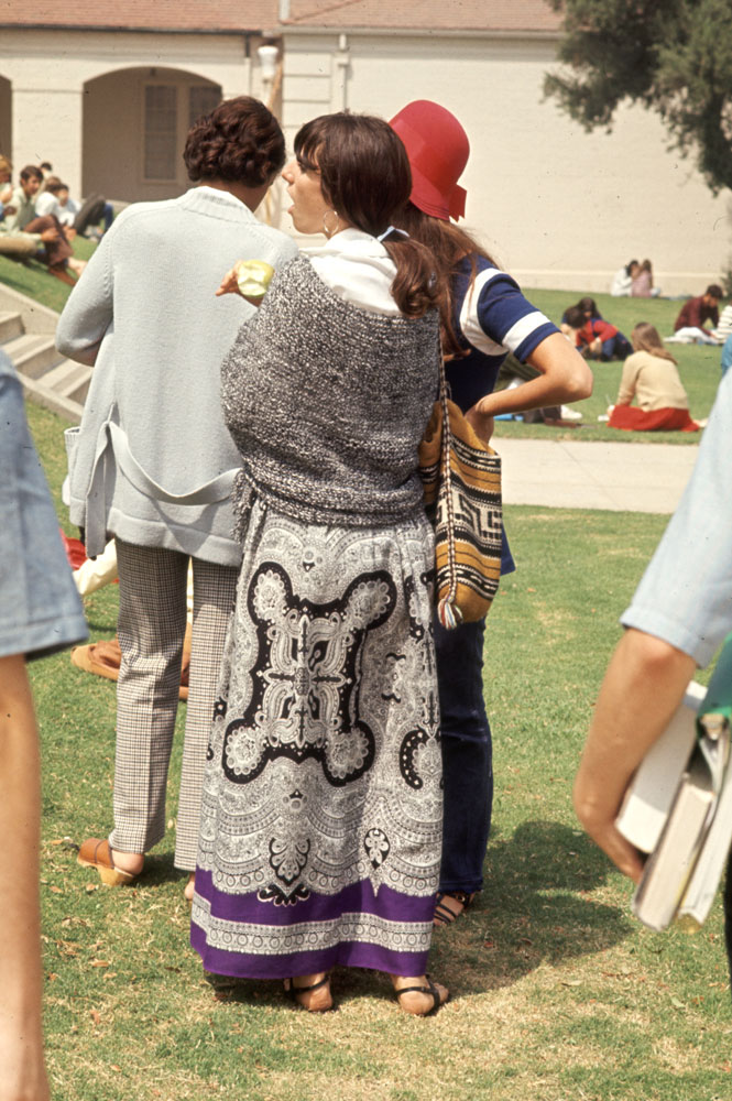 Southern California high school student wears old-fashioned tapestry skirt and wool shawl, 1969.