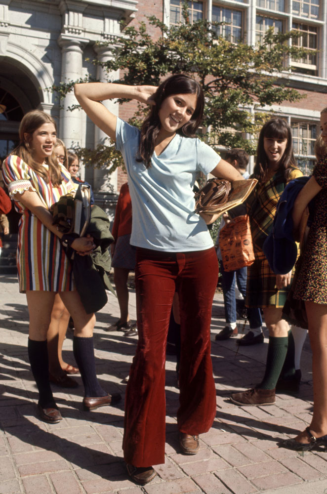 High school student wearing bell bottoms and boots, 1969.