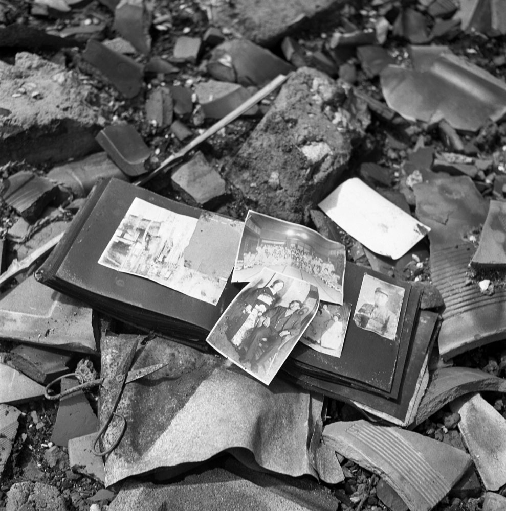 A photo album, pieces of pottery, a pair of scissors - shards of life strewn on the ground in Nagasaki, 1945.