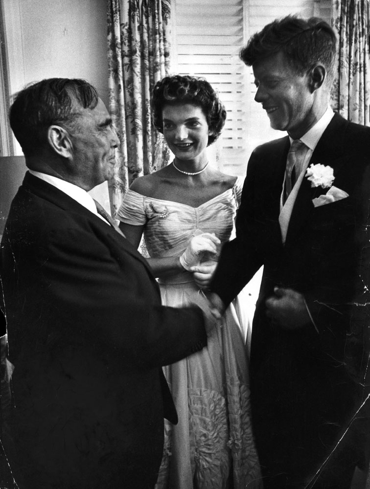 """""""Speaker Joe Martin of House of Representatives congratulates bride and bridegroom in receiving line. Kennedy served three terms in the House."""""""