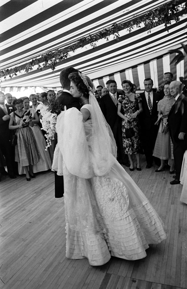 Jacqueline Kennedy dances with her husband, John F. Kennedy, at their wedding reception,