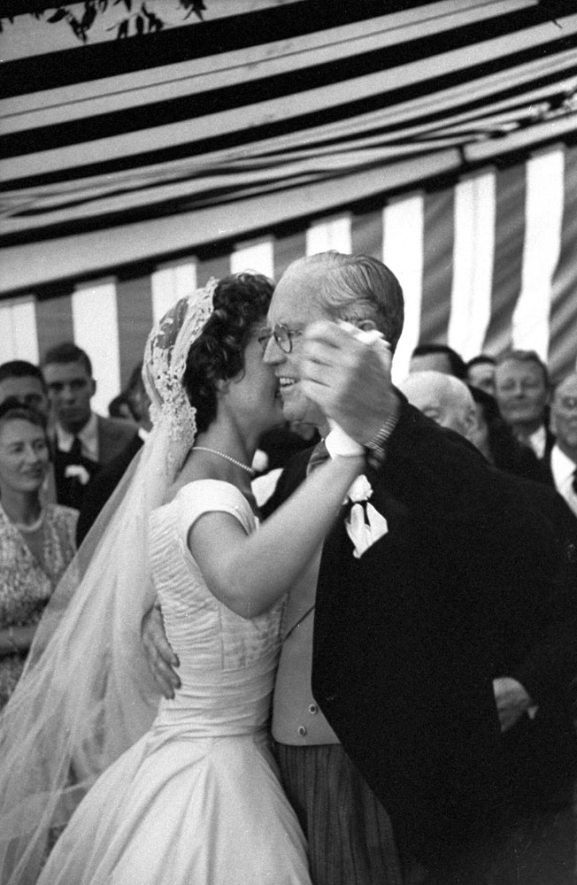 Jacqueline Kennedy dances with her new father-in-law, Joseph P. Kennedy, at wedding reception, Newport, R.I., Sept. 12, 1953.