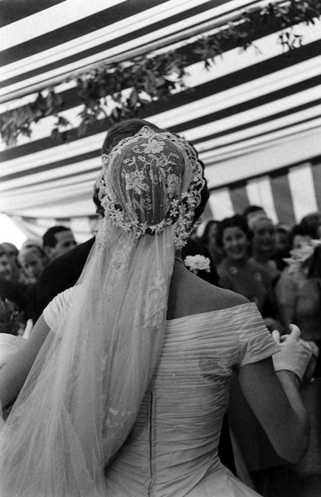 Jacqueline Kennedy dances at her wedding reception, Newport, R.I., Sept. 12, 1953.