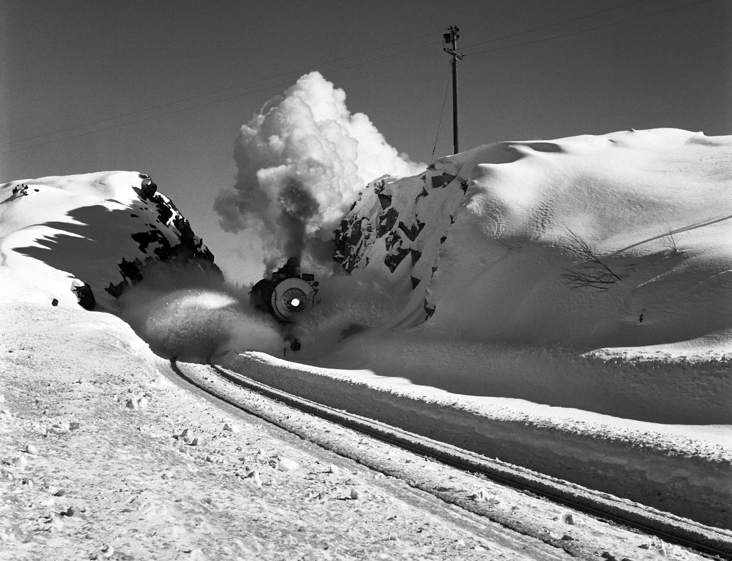 Southern Pacific locomotive using a plow to clear snow from tracks in Donner Pass, five miles west of Soda Springs, Calif., 1949.