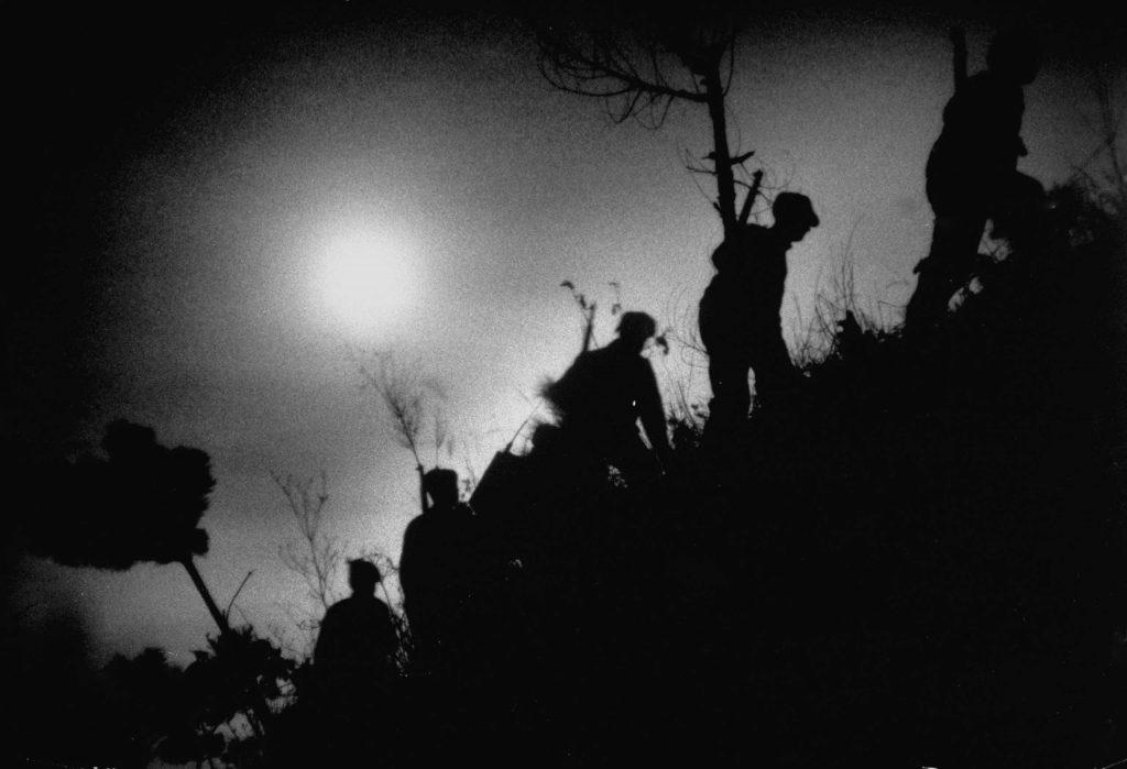 Army unit patrolling at night in Korea, 1951.