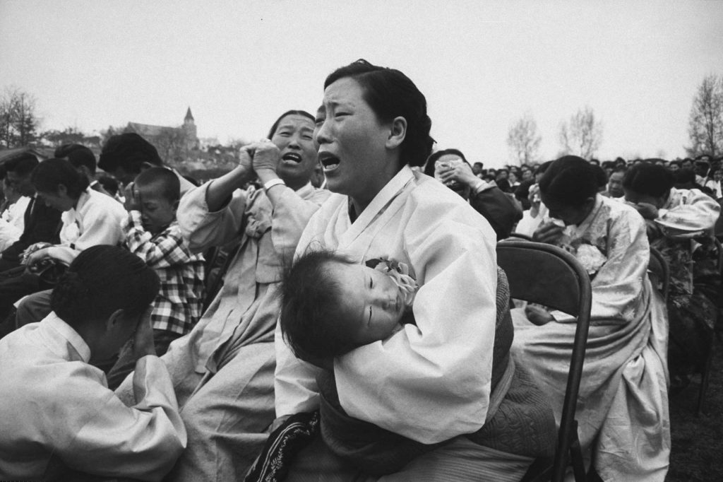 Mothers grieve for their sons killed during a student demonstration, South Korea, 1960.