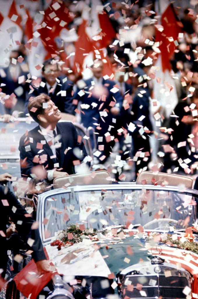 President John F. Kennedy in the midst of a ticker tape parade during a state visit to Mexico, 1962.