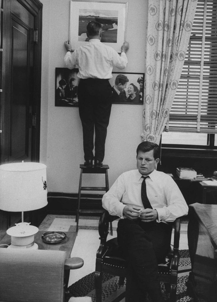 Sen. Edward Kennedy (right) with an old friend, Jack Dixon, in his office during his first year in the Senate, 1963.