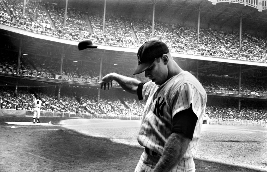 Mickey Mantle tosses his helmet in disgust after a terrible at-bat, New York, 1965.