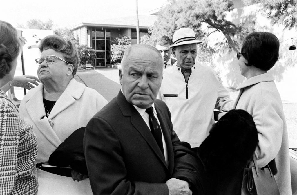 Outside the presidential suite at the Sands Hotel in Las Vegas in 1965, Frank Sinatra says goodbye to his mother, Dolly (left), and his father, Martin (center). They visited from New Jersey during the winter months.