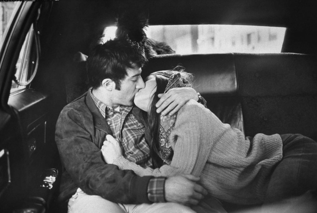 Dustin Hoffman kisses his wife, Anne Byrne, in the back of a taxi, New York, 1969.