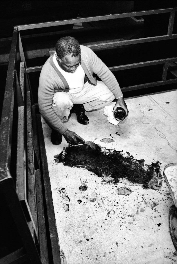 "Theatrice Bailey attempts to clean blood from the balcony, hours after the 6 PM shooting of Dr. King. ""I don't know if there were official people around taking notes and pictures and things like that,"" Groskinsky told LIFE.com. ""Nobody was there when we w"