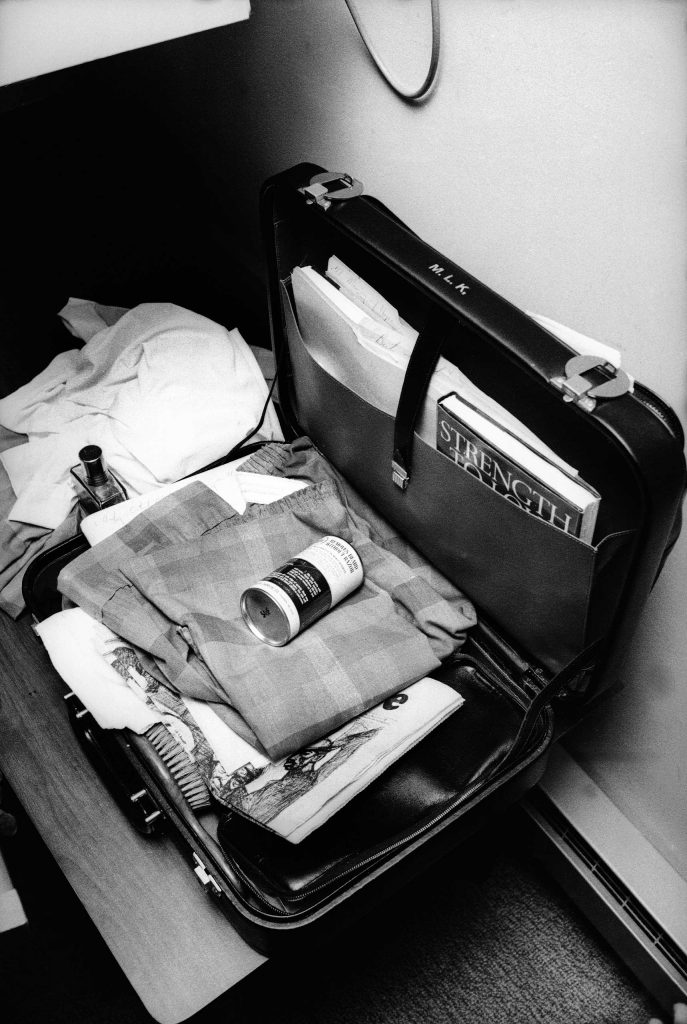 Martin Luther King, Jr.'s neatly packed, monogrammed briefcase in his room at the Lorraine Motel, April 4, 1968   with his brush, his pajamas, a can of shaving cream and his book, Strength to Love, visible in the pocket.