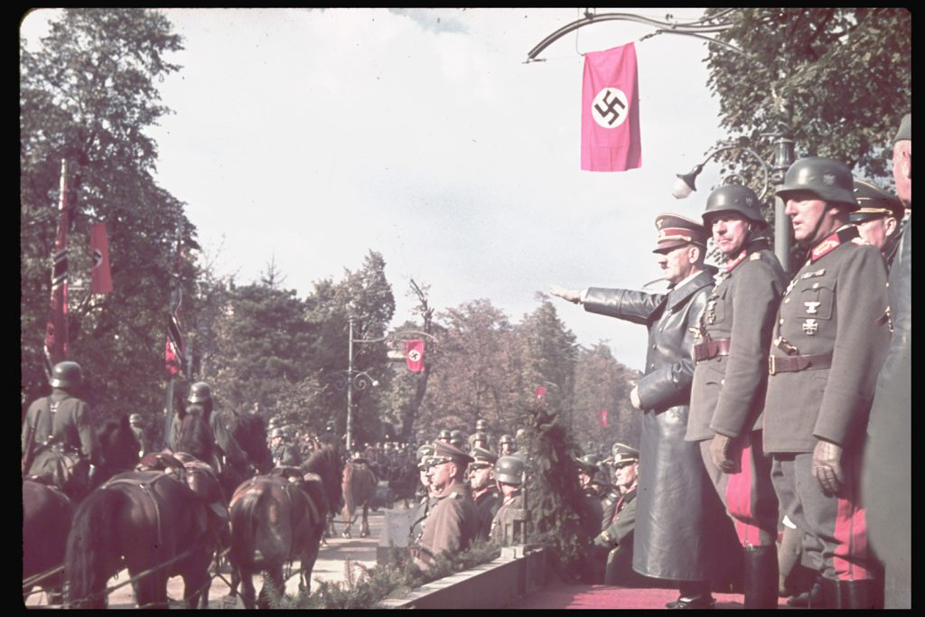 Adolf Hitler views victory parade in Warsaw after the German invasion of Poland, 1939.