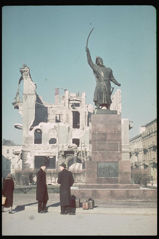 Poles stand beneath monument to Polish patriot, Jan Kilinski, 1939.