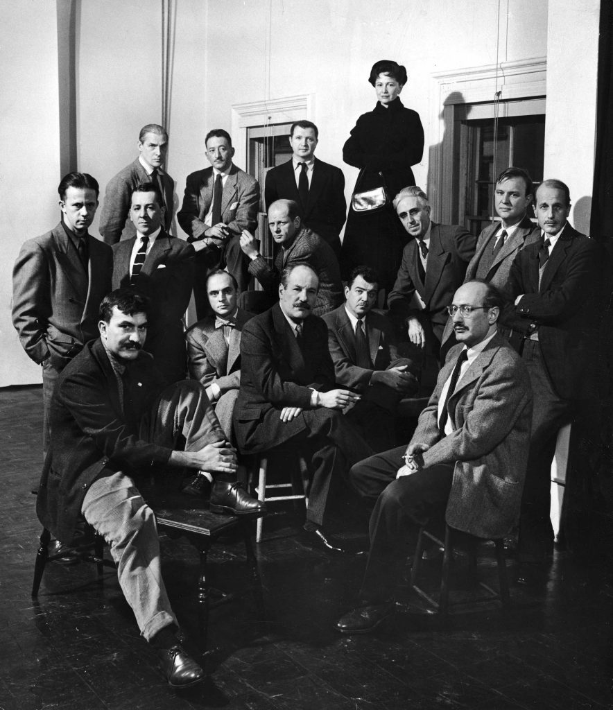 "Caption that accompanied this picture in the Jan. 15, 1951, issue of LIFE: ""Irascible Group of Advanced Artists Led Fight Against Show. From left, rear, they are: Willem de Kooning, Adolph Gottlieb, Ad Reinhardt, Hedda Sterne; (next row) Richard Pousette-Dart, William Baziotes, Jimmy Ernst (with bow tie), Jackson Pollock (in striped jacket), James Brooks, Clyfford Still (leaning on knee), Robert Motherwell, Bradley Walker Tomlin; (in foreground) Theordoros Stamos (on bench), Barnett Newman (on stool), Mark Rothko (with glasses)."""