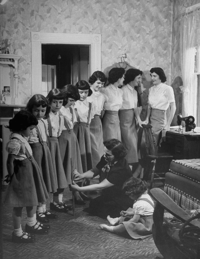 """The famous """"O'Neil sisters"""" (all 10 of them) with their mother, Boston, 1952."""