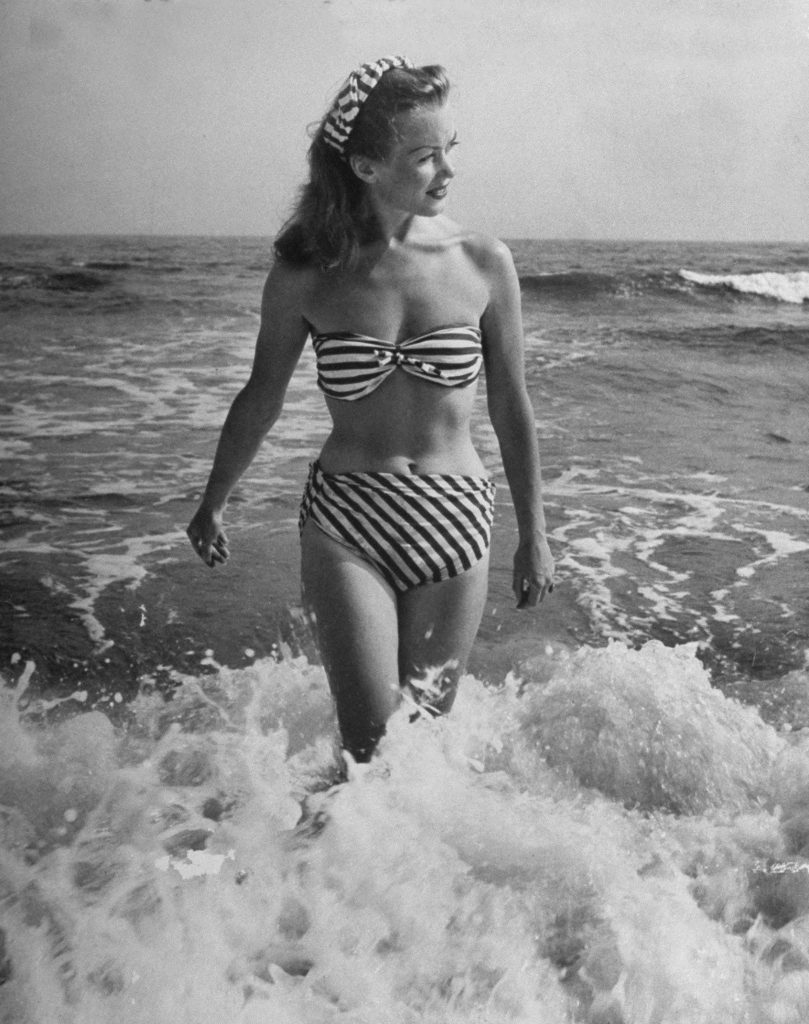 "Caption from the Sept. 2, 1946, issue of LIFE: ""[French actress] Barbara [Laage] wears suit with no fear of disaster, except in a rough surf because it has been tied on with good strong knots."""