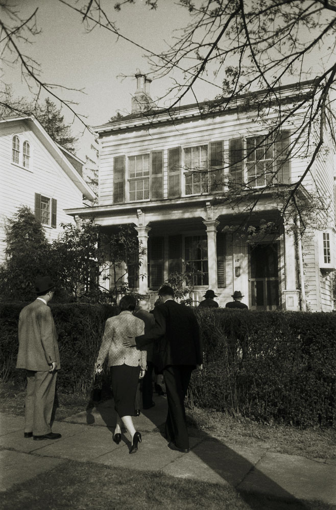 Family and friends return to Einstein's home at 112 Mercer Street in Princeton, where he lived for 20 years, after his funeral, April 18, 1955.