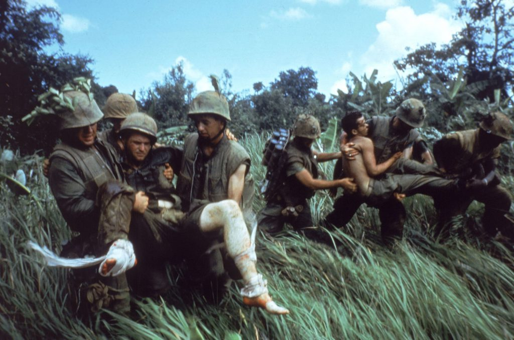Not published in LIFE. U.S. Marines carry their wounded during a firefight near the southern edge of the DMZ, Vietnam, October 1966.