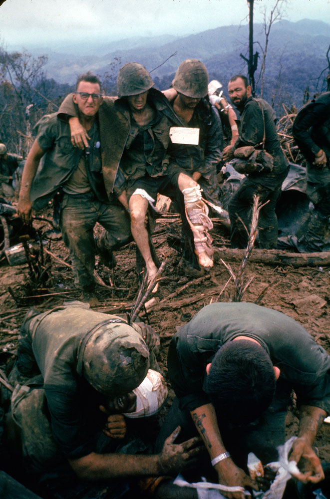 American Marines aid wounded comrades during Operation Prairie near the DMZ during the Vietnam War, October 1966.