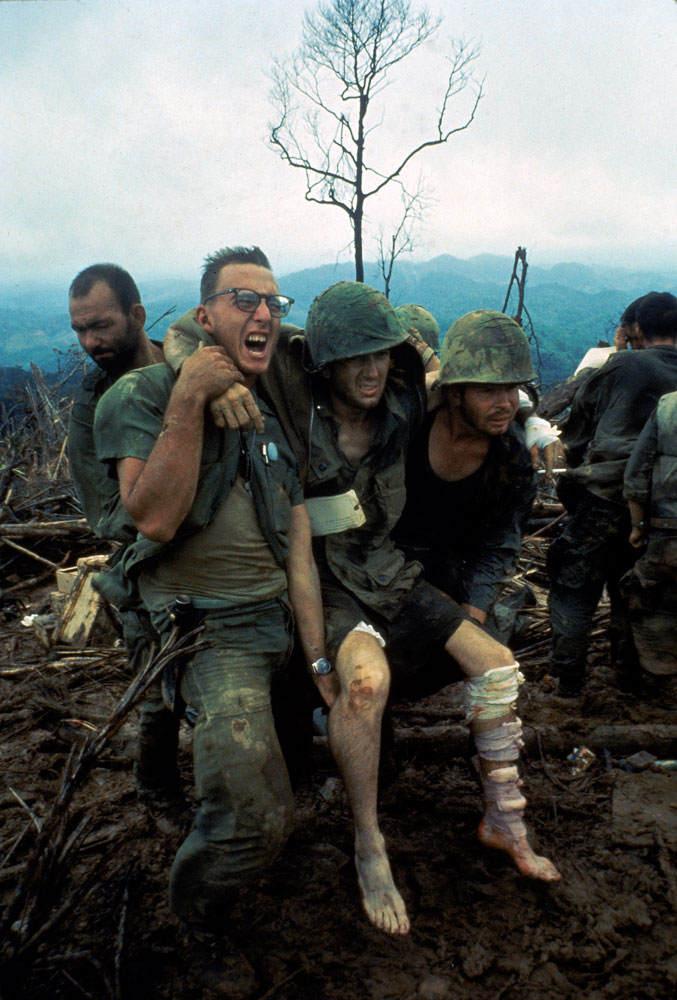 Not published in LIFE. American Marines aid wounded comrades during Operation Prairie near the DMZ during the Vietnam War, October 1966.