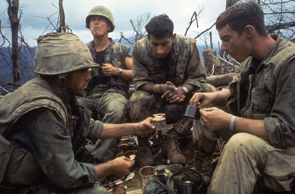 Not published in LIFE. American Marines eat rations during a lull in the fighting near the DMZ during the Vietnam War, October 1966.