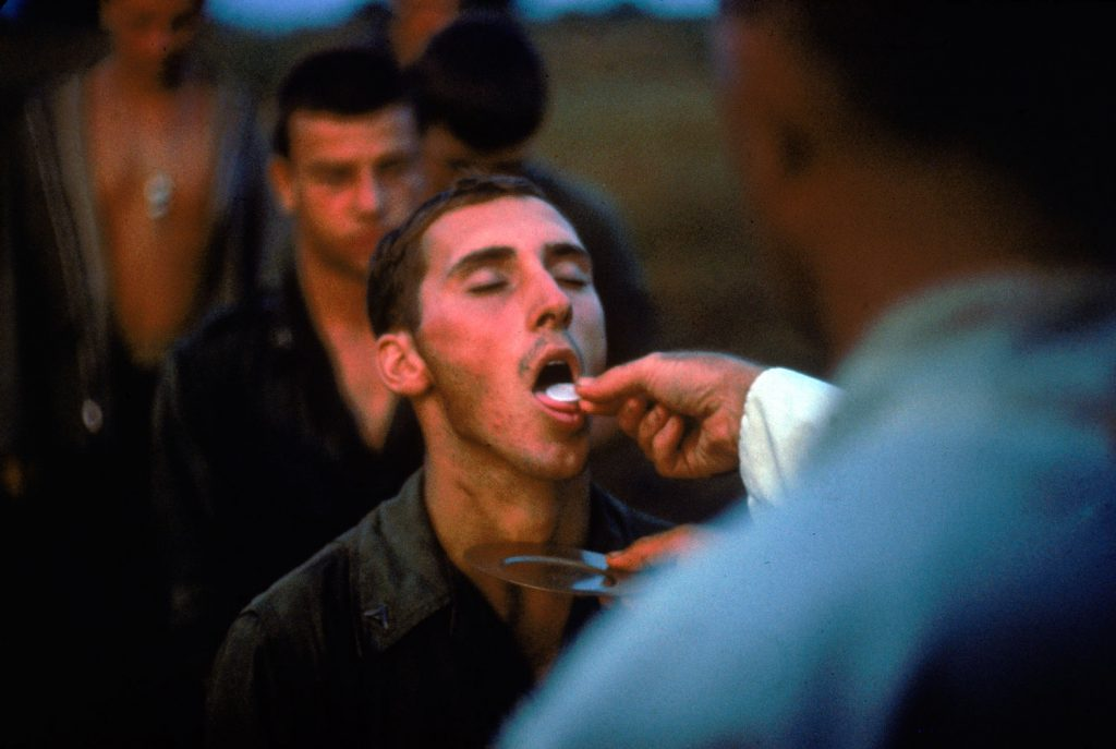Not published in LIFE. American Marines receive the sacrament of Communion during a lull in the fighting near the DMZ during the Vietnam War, October 1966.