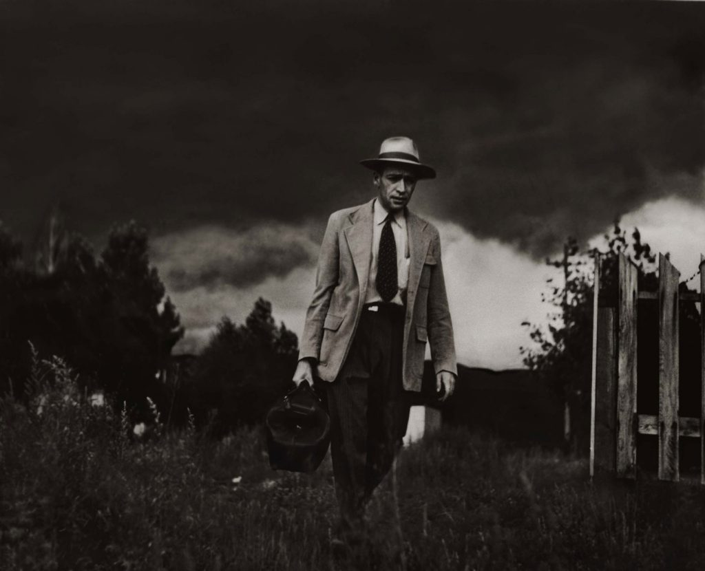 Dr. Ernest Ceriani makes a house call on foot, Kremmling, Colo., 1948.