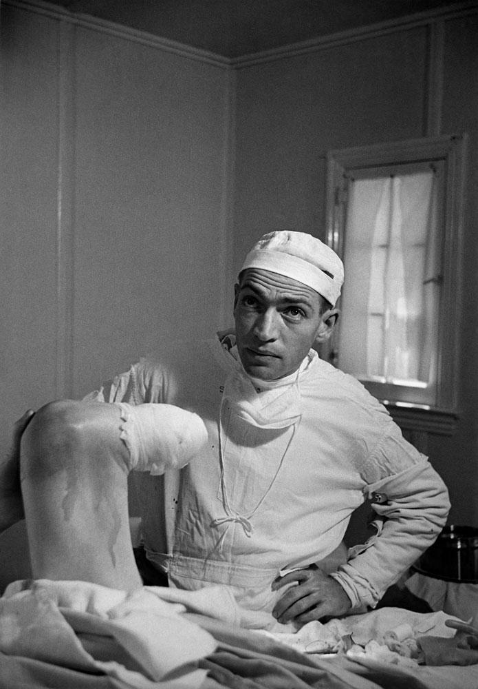 Not published in LIFE. Dr. Ceriani examines his handiwork after the partial amputation of a patient's leg, Kremmling, Colo., August 1948. The patient, Thomas Mitchell, was suffering from a gangrenous infection.