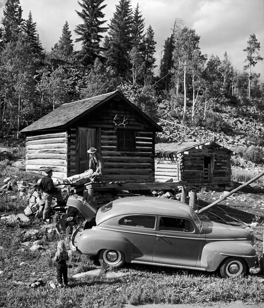 Not published in LIFE. Doctor Ceriani and town marshal Chancey Van Pelt carry a patient from a cabin in the hills near Kremmling, Colo., 1948.