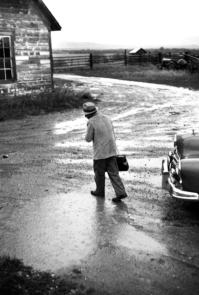 Not published in LIFE. Dr. Ernest Ceriani on his way to a house call in foul weather, Kremmling, Colo., 1948.