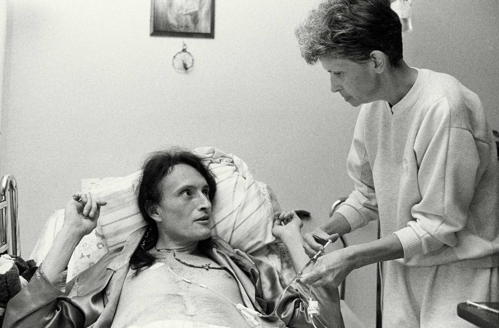 Kay Kirby administers medicine to Peta via an IV, 1992.