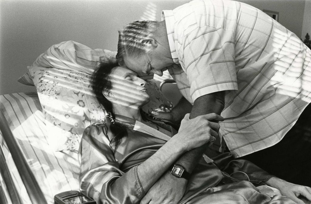 Peta and Bill Kirby share a quiet moment together in Peta's room, Ohio, 1992.