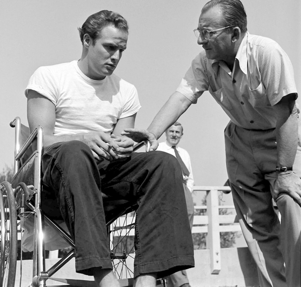 Marlon Brando chats with a production manager for 'The Men,' 1949.