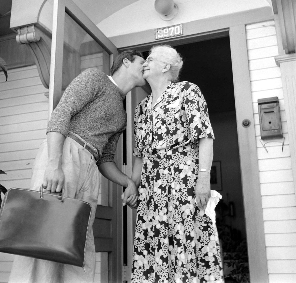 Marlon Brando kisses his grandmother as he heads to the studio for a day of filming The Men, 1949.