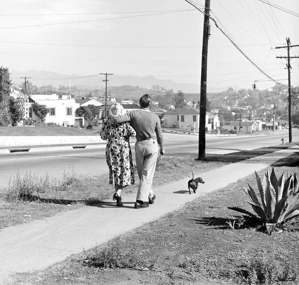 Marlon Brando goes for a stroll with his grandmother and her dog, 1949.