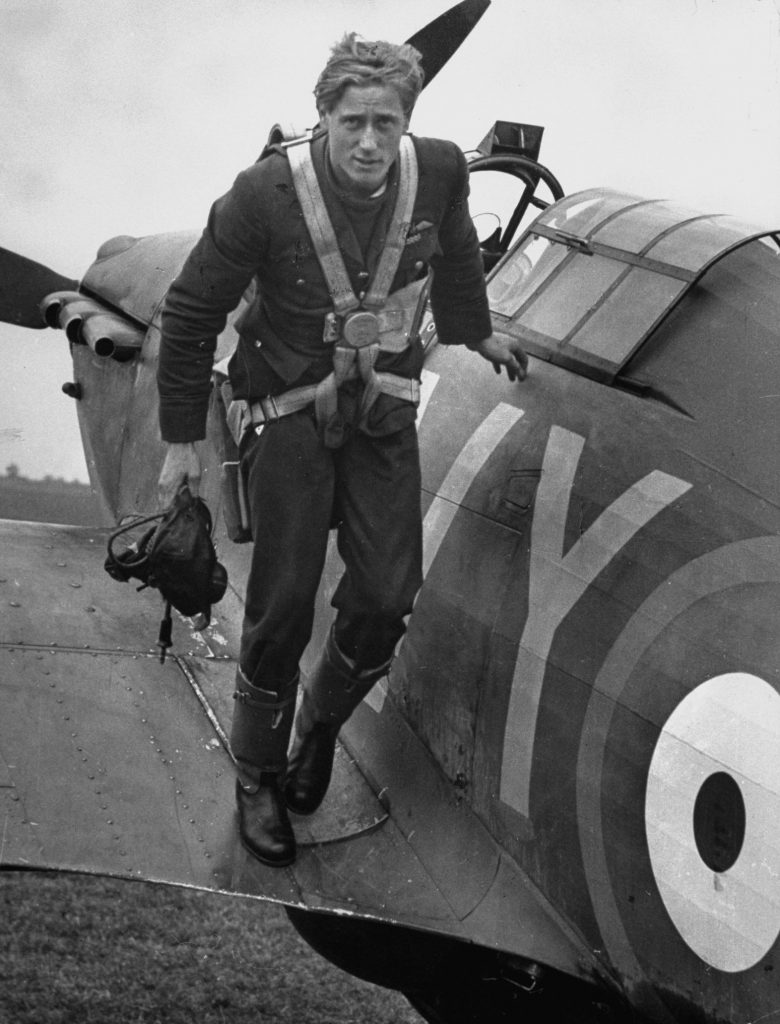 Royal Air Force ace Albert Gerald Lewis climbs out of his plane after an air battle above England, 1940.
