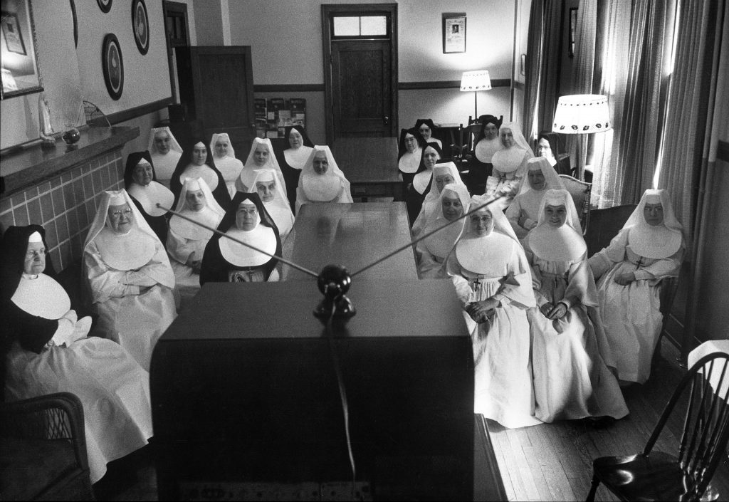 Sisters at St. Vincent's Hospital in Erie, Penn., watch a program on a new local TV station, 1949.