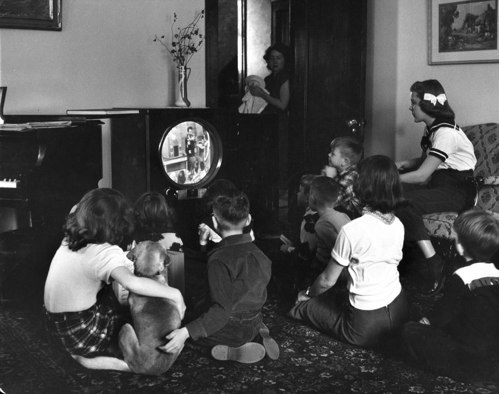 "Grade school kids in Minneapolis watch a video ""classroom lesson"" on TV while the city's public schools are on strike in 1951."