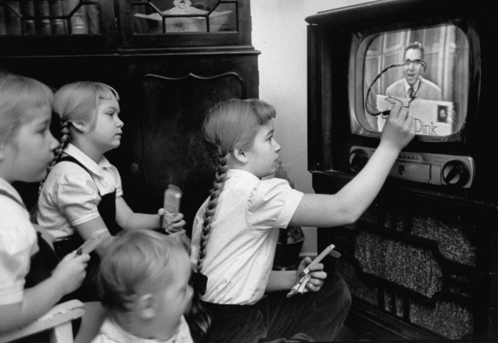 "Six-year-old girls use a ""Winky Dink"" drawing kit on their home TV screen as they watch the kids' program, 1953. The show, which aired for four years in the 1950s, has been cited as ""the first interactive TV show,"" especially in light of its ""magic drawing screen""   a piece of plastic that stuck to the TV screen, and on which kids (and, no doubt, some adults) would trace the action on the screen."