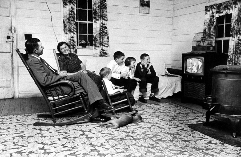 Tenant farmer Thomas B. Knox and his family watch Ed Sullivan and ventriloquist Rickie Layne on The Ed Sullivan Show in 1958.