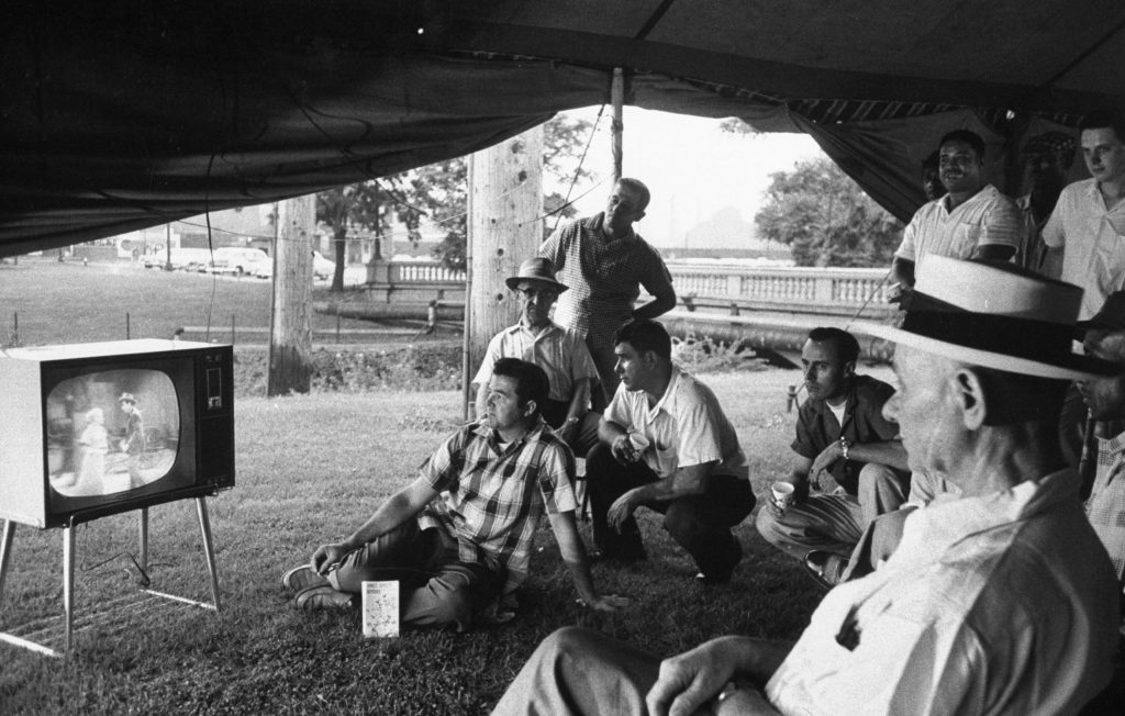 Picketers watch TV in a tent outside the gates of a U.S. Steel plant in Gary, Indiana, during a strike in 1959.